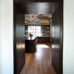 Entry to kitchen with complete wood surround