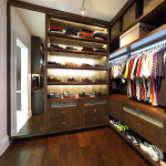 Shoe wall and storage in his closet